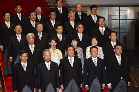 In Cabinet reshuffle, Abe shifts focus to economy but