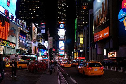 Times Square photos - neon signs, taxi cabs and billboards
