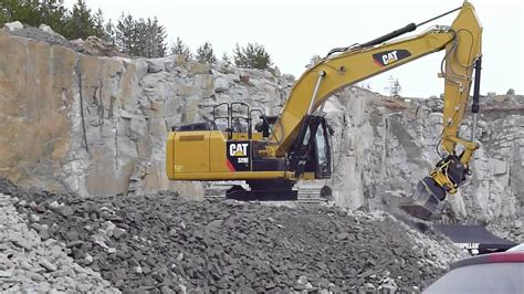New Cat 329E with Engcon Tiltrotator - YouTube